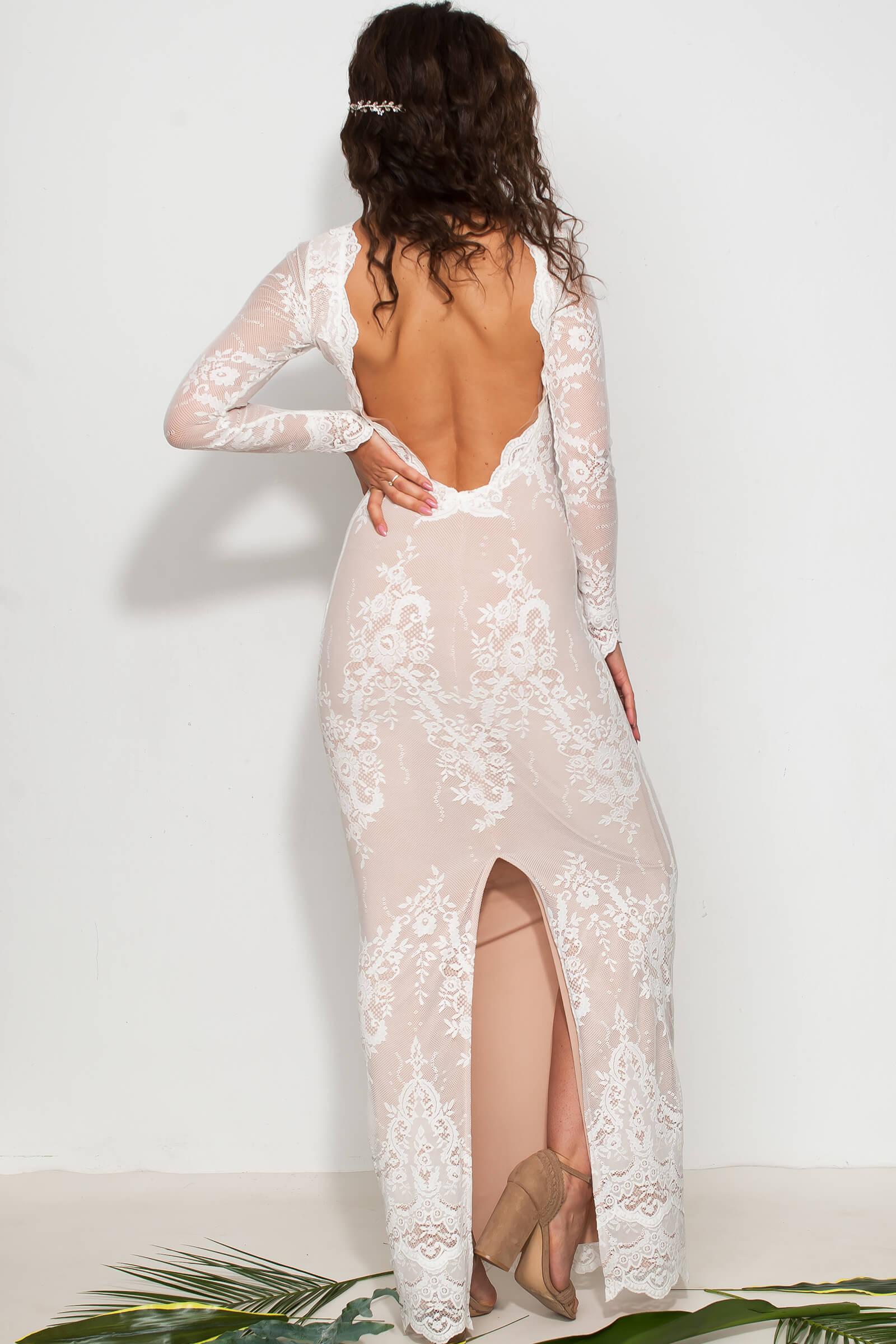 Dopasowana suknia ślubna w kwiaty. Suknia wieczorowa.